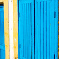 old door in morocco africa ancien and wall ornate blue yellow Royalty Free Stock Photo
