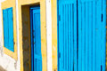 old door in morocco africa  wall ornate blue yellow Royalty Free Stock Photo