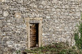 Old door on an old stone house in Dobrinj, island Krk, Croatia. Royalty Free Stock Photo