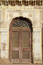 Old door and ornate wall in india brown Royalty Free Stock Photography