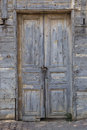 An old door with padlocks on a chain Royalty Free Stock Photo