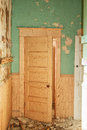 An old door with peeling paint in a abandoned building Royalty Free Stock Photos