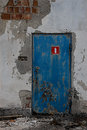 Old door with red sign Stock Images