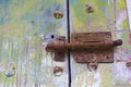 Old door with rusty latch. Royalty Free Stock Photos
