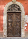 Old door in saluzzo port the historic center of Royalty Free Stock Images