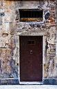 Old door in stone wall Stock Photography