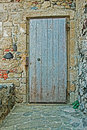 Old door in a stone wall Royalty Free Stock Photo