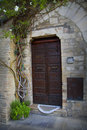 Old door in the tuscany town of assisi close up with an italy Royalty Free Stock Images