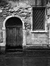 Old door in venice opening on to a canal Royalty Free Stock Photo