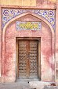 Old door in the walled city of lahore pakistan with mughal architecture design Royalty Free Stock Image
