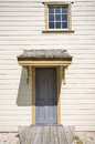 Old door and window a view of an with a shingle roof a skew Royalty Free Stock Photos