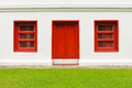 The old door and windows red on white wall Royalty Free Stock Photo