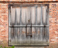 Old door wooden with brick wall Royalty Free Stock Photography