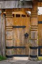 Old door wooden with metal hinges Royalty Free Stock Photography