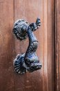 Old doorhandle in the form of an iron fish Royalty Free Stock Photo
