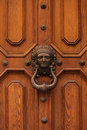 Old doorhandle in the form of a woman's face Royalty Free Stock Photo