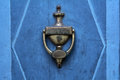Old doorknocker from brass on a blue  door Royalty Free Stock Photo