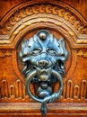 Old doorknocker at a front door Royalty Free Stock Photo