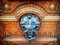 Old doorknocker at a front door Stock Photography