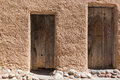 Old doors on adobe wall Royalty Free Stock Photo