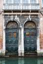 Old doors in venice italy and canal the city of Royalty Free Stock Images