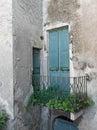Old doorway, forgotten neglected garden. Italy. Royalty Free Stock Photo