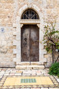 Old double door with half round transom jerusalem iron on one of the streets of israel Stock Images