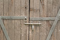 Old double wooden door with metal hinges and lock Stock Photography