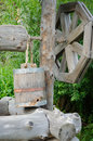 Old draw well with wooden bucket Royalty Free Stock Photo
