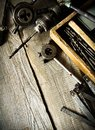 Old drill, a box with drills, pliers and ruler on Royalty Free Stock Photo