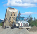 An old dumptruck at a rustic quarry in the yukon