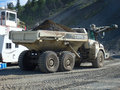 An old dumptruck at a rustic stone-crushing quarry in the yukon