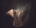 Old dusty book holding an open with dust coming out Royalty Free Stock Photography