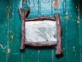 Old dusty mirror with cobwebs and scratches  cracks on the wooden floor painted  oil paint Royalty Free Stock Photo