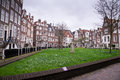 Old Dutch buildings of the Begijnhof surrounded by a park in Amsterdam Royalty Free Stock Photo