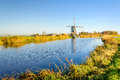 Old Dutch windmill at the bank of a canal Royalty Free Stock Photo