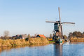 Old Dutch windmill at the edge of a small river Royalty Free Stock Photo