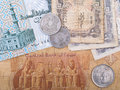 Old Egyptian banknotes and coins Royalty Free Stock Photo