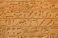 Old egyptian pictorial writing on a sandstone an Stock Image