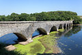 Old eight arch bridge in welsh countryside stone over bosherston lakes pembrokeshire wales Royalty Free Stock Images