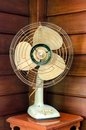 Old electric fan on wood table Stock Photo