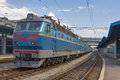 Old electric locomotive at railroad station suburban train parked in kiev ukraine Stock Images