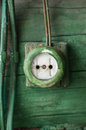 Old electric outlet on wooden wall Royalty Free Stock Photo