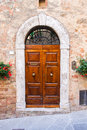Old elegant door in italy wooden italian vilage Stock Image