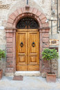 Old elegant door in italy wooden italian vilage Stock Images