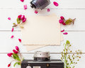 Old empty photo frame, retro camera, photo film roll and flowers Royalty Free Stock Photo