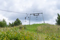 Old empty ski lift in summer landscape Royalty Free Stock Photo