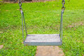 Old empty swing on playground Royalty Free Stock Photo
