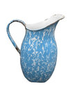 Old enamel metal pitcher isolated blue and white coated with handle on white Royalty Free Stock Image