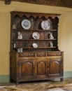Old english antique oak kitchen dresser hand made and carved wooden Stock Images